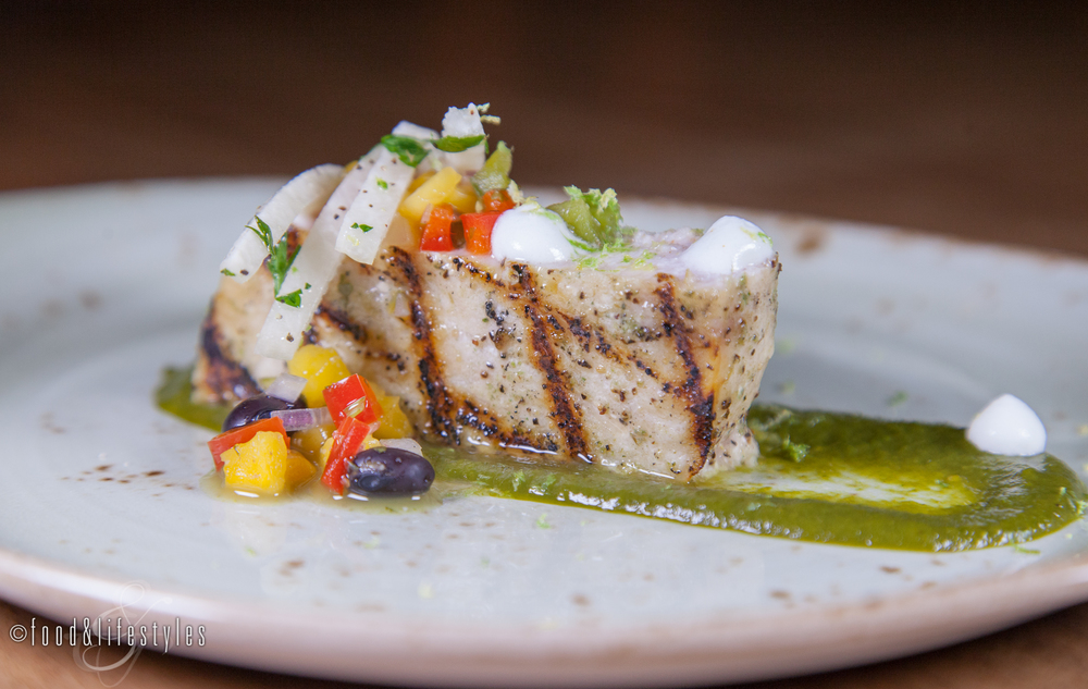 Swordfish with tomatillo-pineapple puree, mango-black bean salsa, jicama, and lime buttermilk
