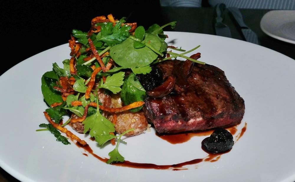 Prime flat iron with garlic-cherry glaze