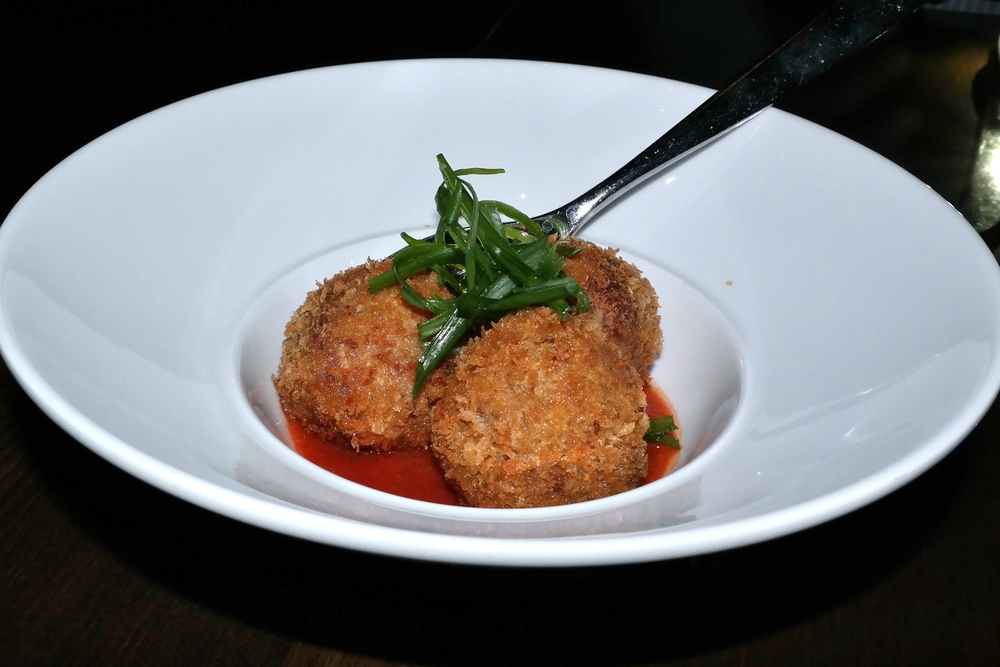 Boudin balls with tomato jam and green onion