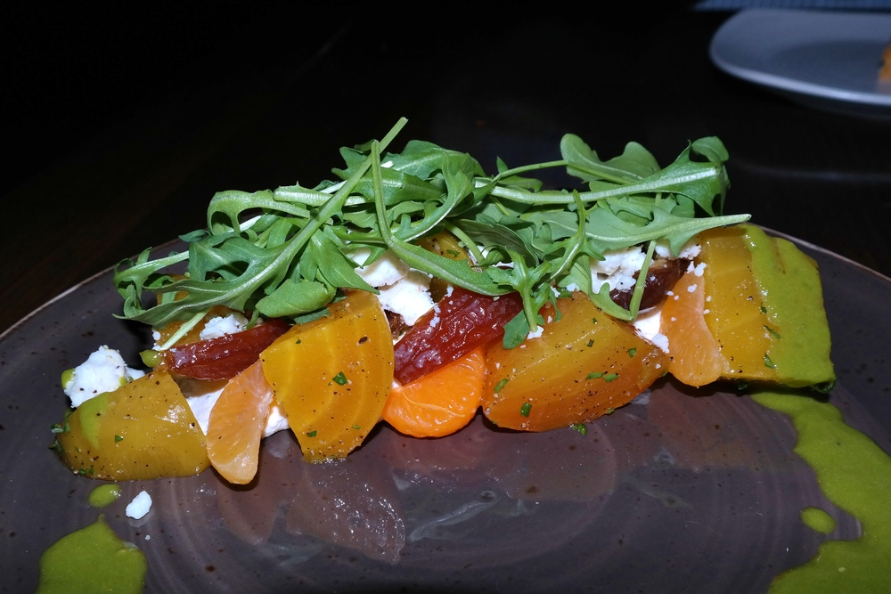 Roasted beet salad with Medjool dates, arugula, clementine, and Crow's Dairy black pepper feta