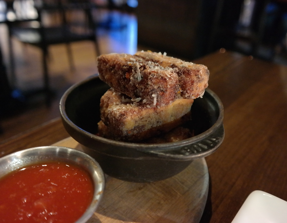 Corn Grit Fries with bacon and white cheddar served with pomodoro dipping sauce.