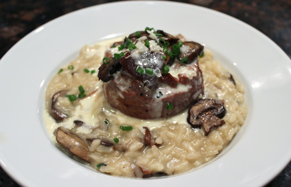 Filet mignon with mushroom risotto and truffle cream sauce.