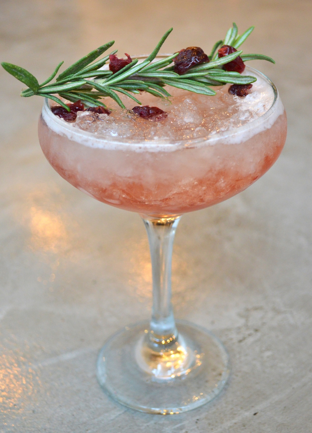 Champagne Julep (champagne, Maison Rouge vsop cognac, rosemary, spiced cranberry)
