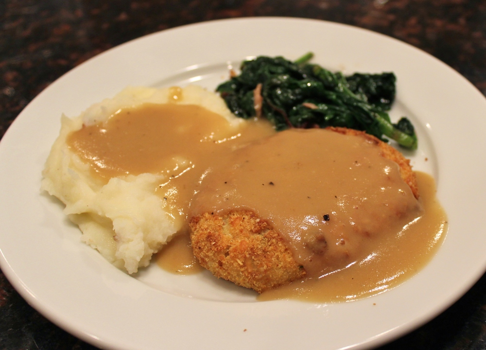 Chicken croquettes with mashed potatoes and spinach from the garden