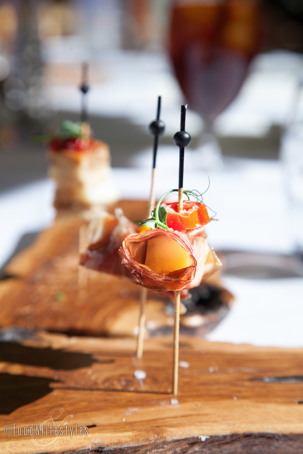 Jamón Serrano with mozzarella and marinated tomatoes