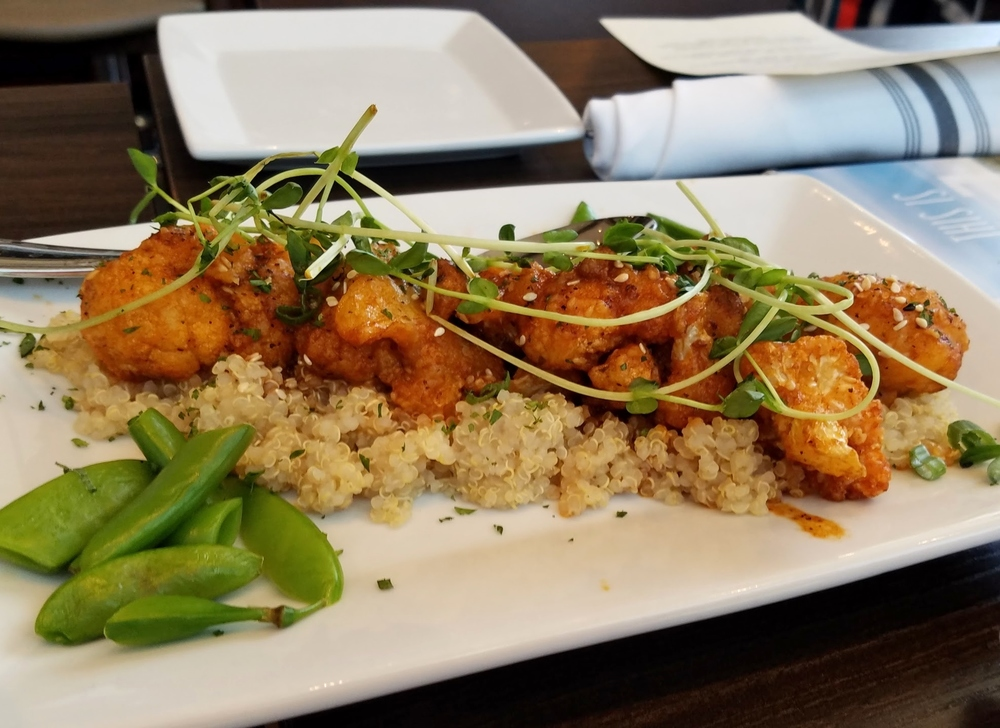 Korean fried cauliflower with quinoa, sugar snap peas, and pea shoots