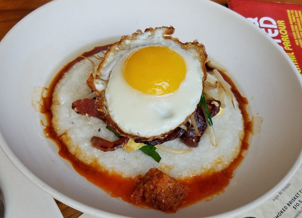 """Grits & Eggs"" with Chinese sausage, garlic chives, bean sprouts, soy, Homeboy's Hot Sauce, sesame shallot oil, homemade bagoong"