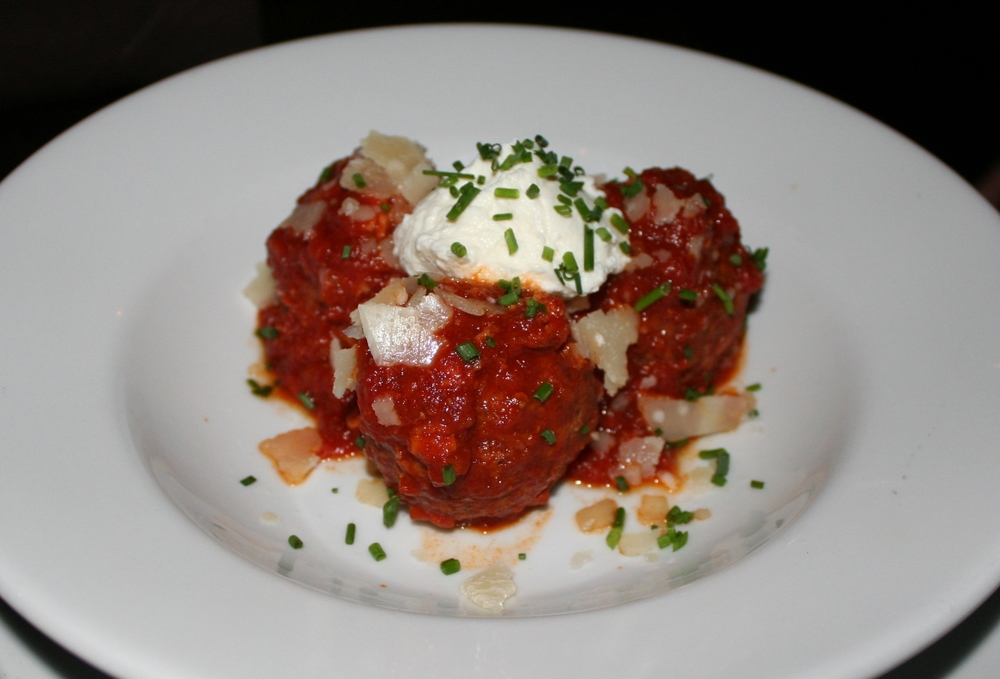 Pork meatballs with ground pork, prosciutto and mortadella with pomodoro sauce and whipped ricotta