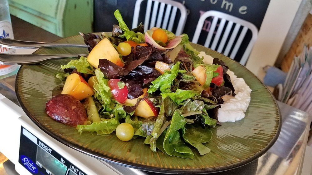 Heirloom greens salad with figs, grapes, peaches, ricotta and balsamic-pomegranate vinaigrette