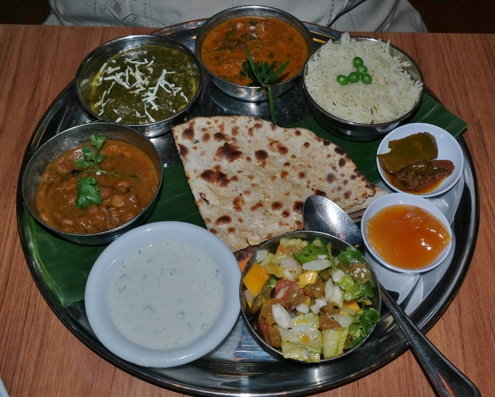 Vegetarian curries of  chana masala  (chickpeas, dried mango, bay leaves, ginger, onion, roasted cumin powder),  saag paneer  (spinach, fresh mustard leaf, ginger, garlic, fenugreek) and  dal makhani  (black urda and chana lentils, kidney beans, ginger, garlic, tomato, cream, cumin) and  mango salad  with raisins and almonds.