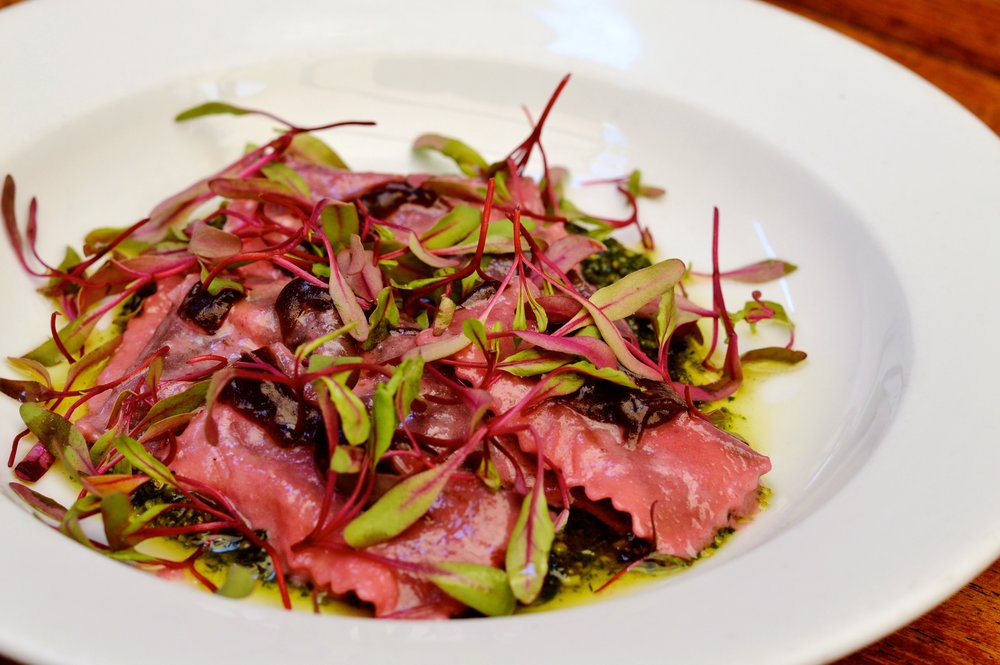 Agnolotti with beet pasta, carrot top pesto, fig vinaigrette and microgreens (Photos: Emily Foree)