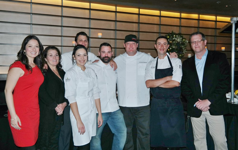 Left to right: Jessica Keener, Kim Stemler, Ana Garza, Johnny De Vivo, Matthew Beaudin, Beau MacMillan, Chris Schuetta, and Rob O'Keefe.