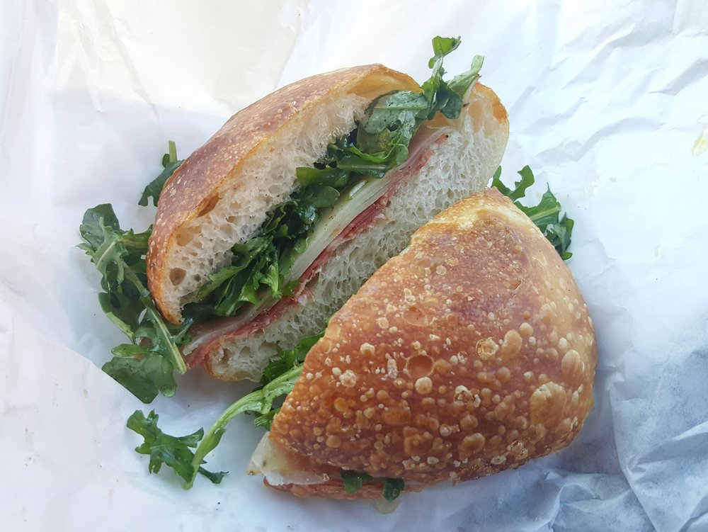 Sopressata, arugula, and Abbaye de Belloc cheese on ciabatta