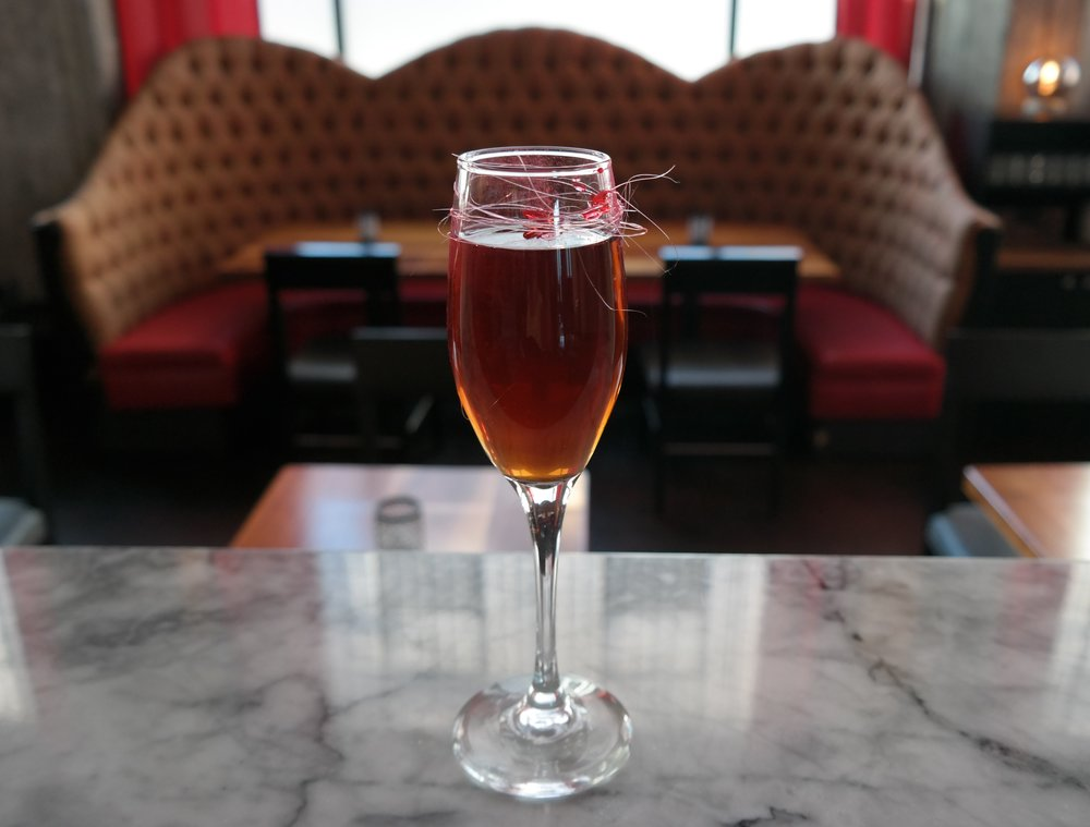 From  Friends with Benefits , created by Declan McGurk of the American Bar at The Savoy in London: The Roaring '50s, made with reposado tequila, Cynar (an artichoke amaro), Cocchi Vermouth, housemade grenadine, and a spritz of absinthe.