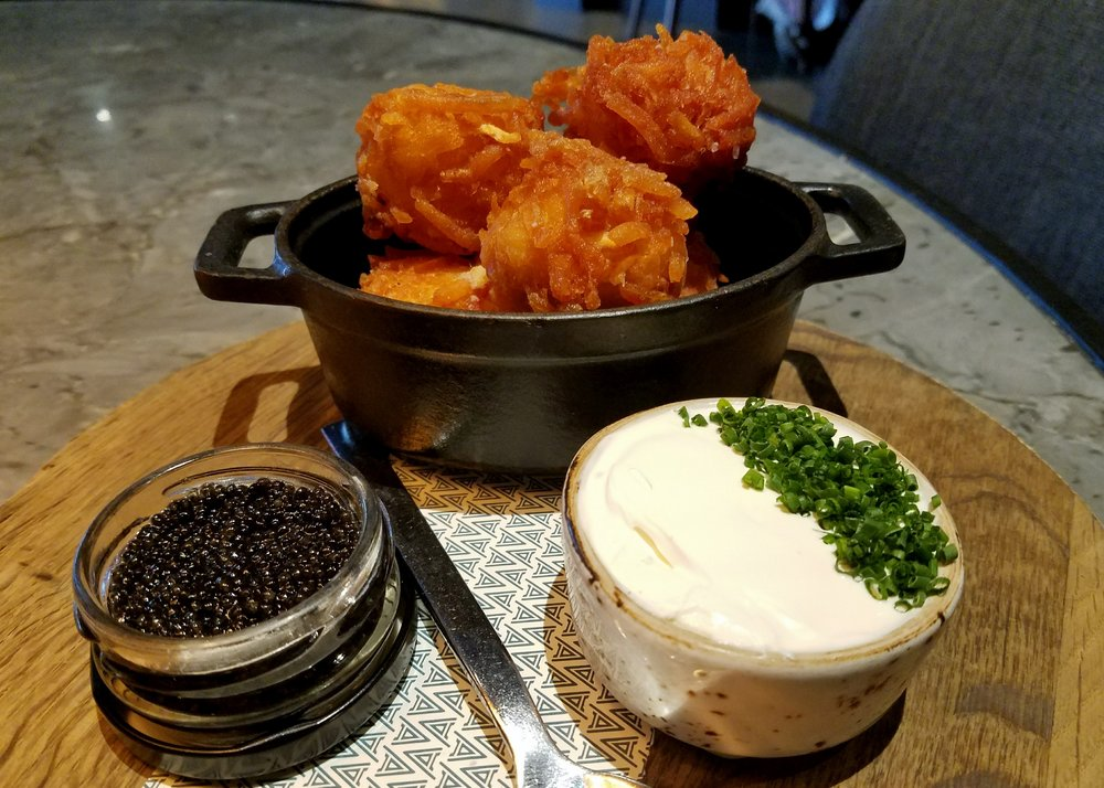 Aji amarillo tater tots with Osetra caviar and creme fraiche