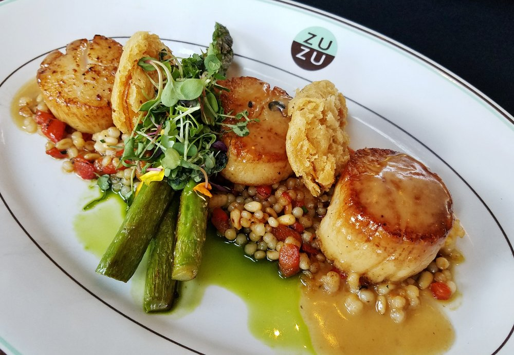 Hokkaido scallops with shellfish butter, asparagus, fried meyer lemon, toasted couscous