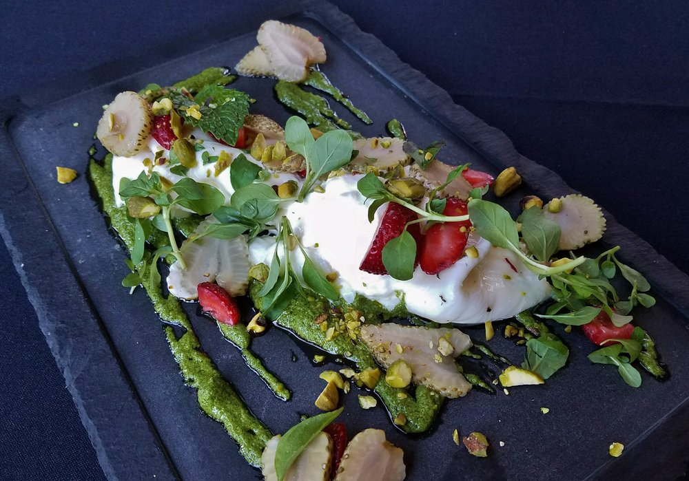 Burrata with pickled green strawberries, toasted pistachio, mint pistou, thai basil, strawberry vinegar, smoked sea salt