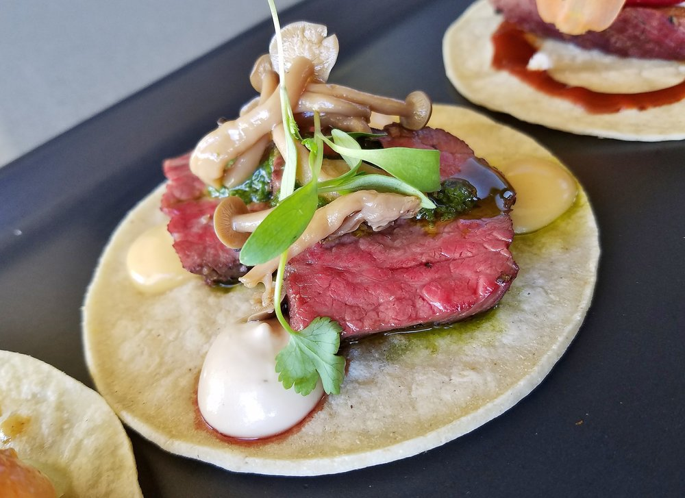 Wagyu cap steak taco, karashi mustard, horseradish crema, pickled shimeji mushrooms.