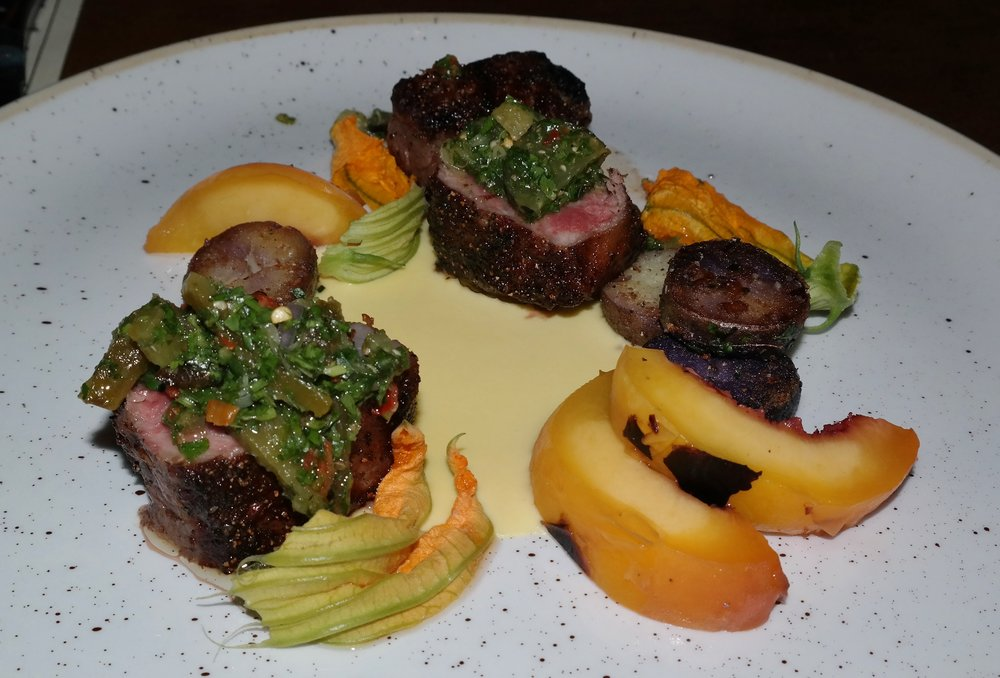 Steak with chimichurri and peaches