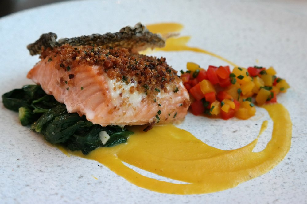 Ora king salmon, Noble millet gremolata, and golden pepper beurre blanc