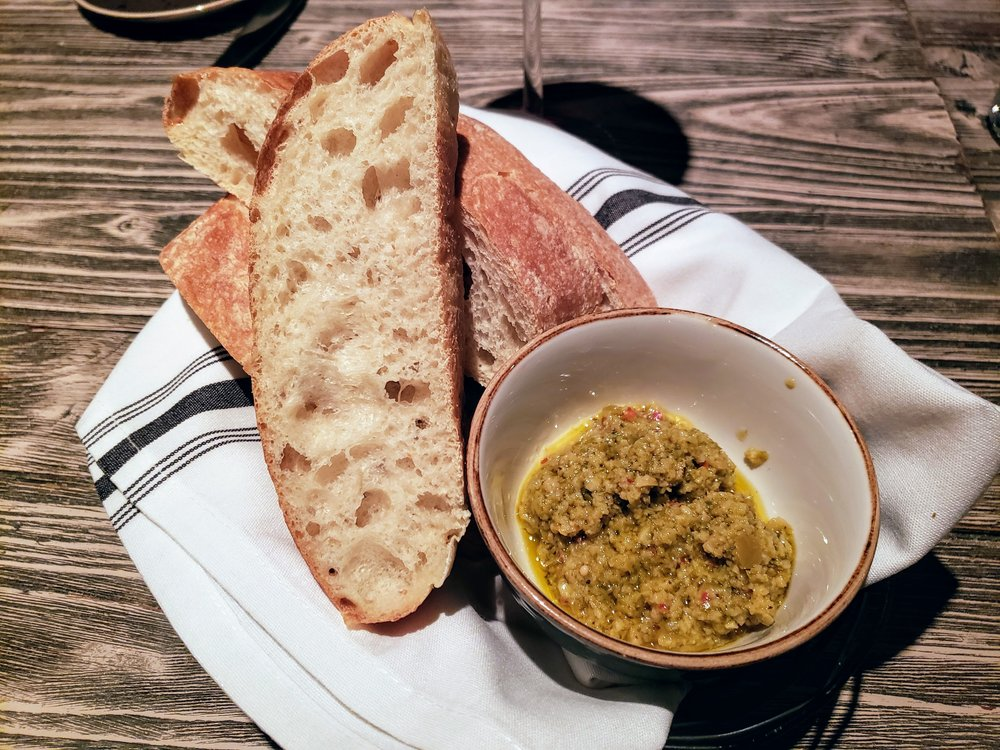 Bread and Calabrian chile and green olive tapenade