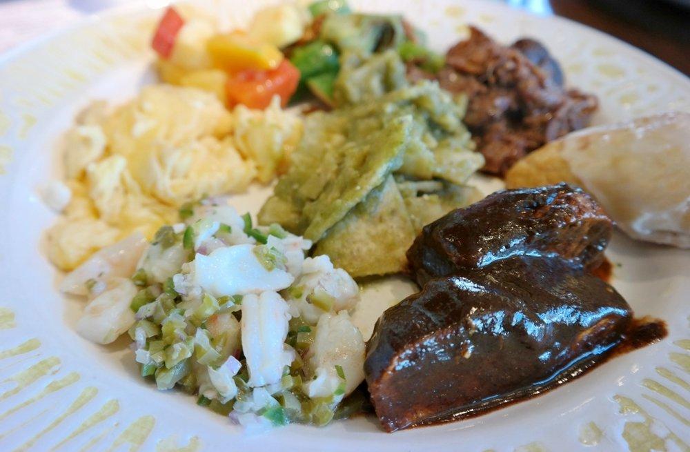 Ceviche,, chicken mole, chilaquiles, barbarcoa, nopales, empanadas, and more