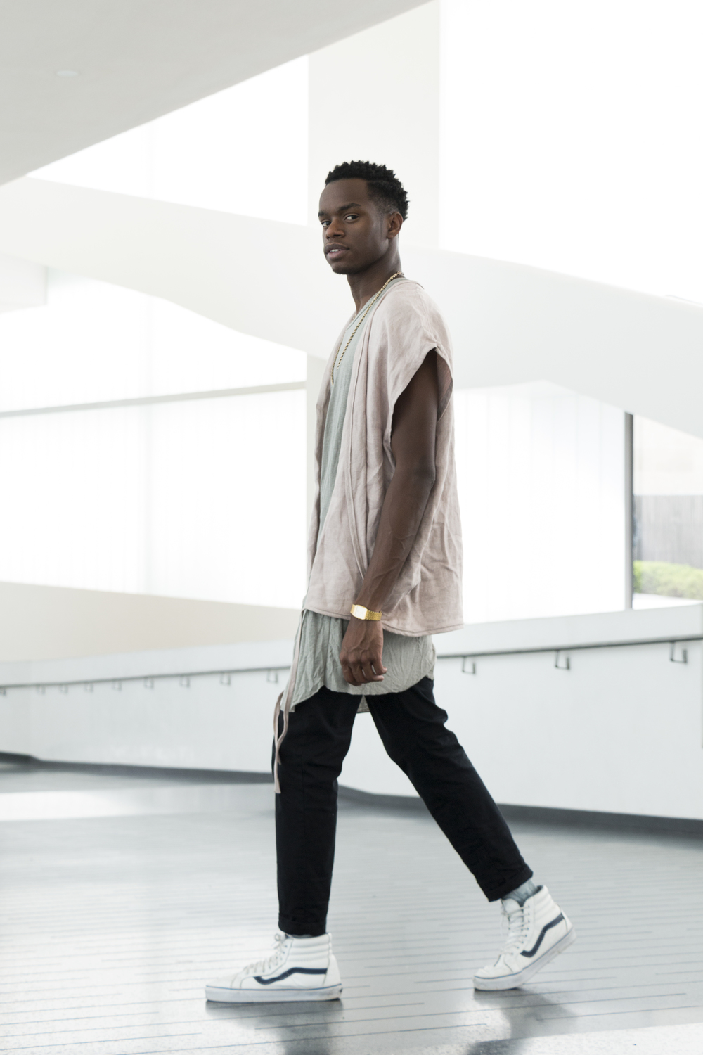 This image depicts designer Myles Thompson wearing an outfit from his collection called Myles Lorenzo, a collaboration between both Myles and Luis Gonzalez. This collection follows the progression of the Margin Collection and Contemporary Unisex Streetwear.      To learn more about this, please visit www.myleslorenzo.com or click the image.