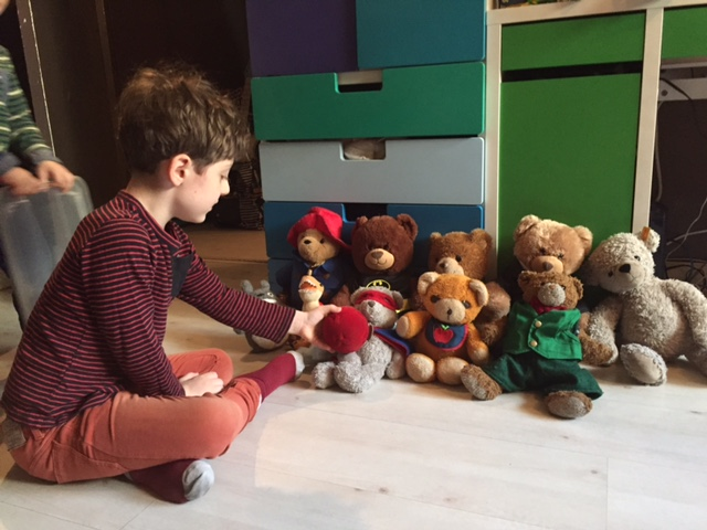 """Zephyr passed the ball from one bear to the next, chanting """"round and around and around it goes, where it stops nobody knows"""" until it landed on a bear, and then either Zephyr or Lyric would say their name (depending on whose bear it was). They had slightly different voices for each bear."""