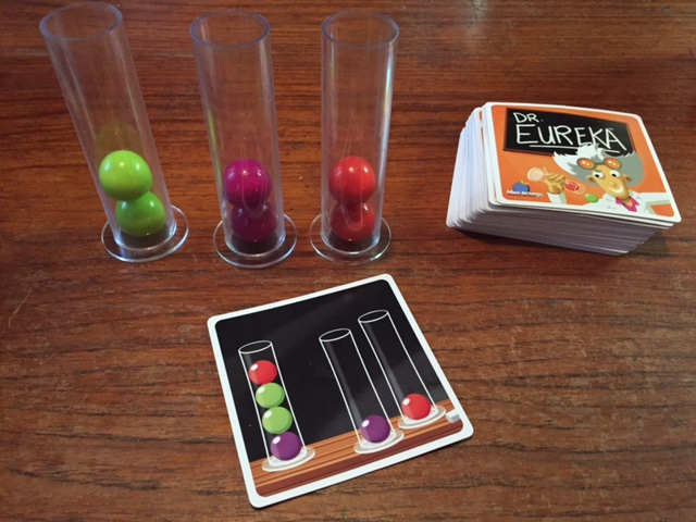 DR. EUREKA's test tubes, colored molecule balls, and challenge cards