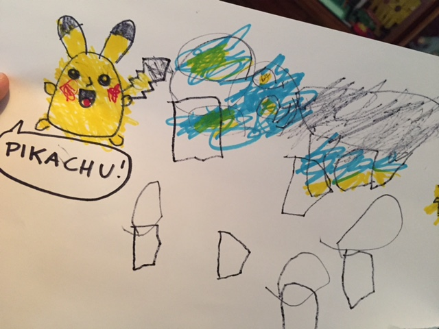 I drew Pikachu for Lyric to color in, and he did a pretty awesome job staying inside the lines. And then he drew his own Luxio next to that. Not too shabby! I see what he's trying to do there.