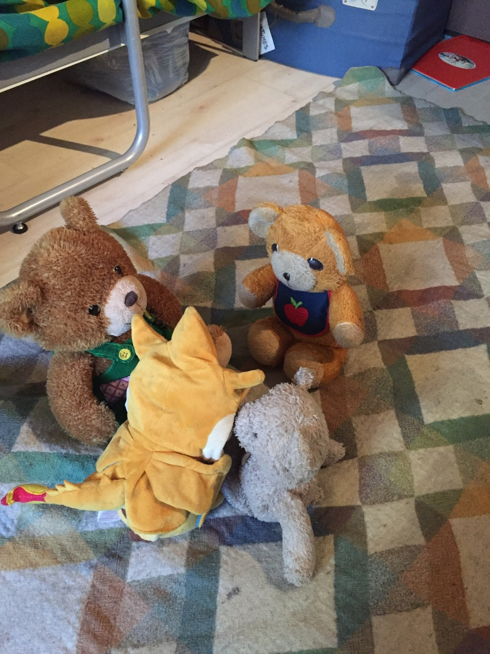 These guys gathered on the blanket for dramatic play