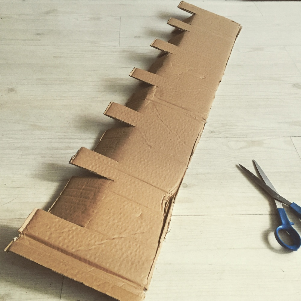 Step 3) cut crenellations and fold down longer flaps