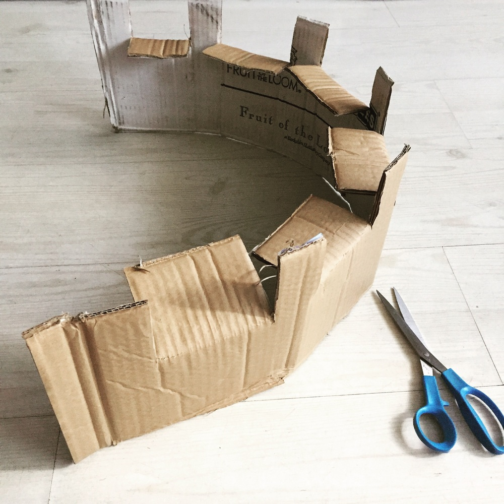 Step 4) Fold along the grain of the cardboard to create castle shape