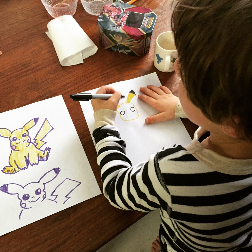 Zephyr working on his Pikachu next to mine