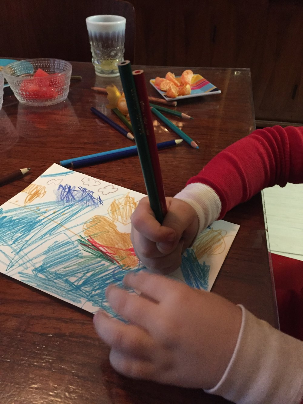 Lyric showing the five year old focus (two pencils at once!)