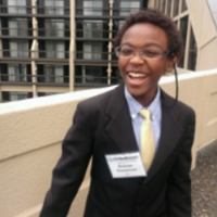 Subi  is an 8th grade student at Open Window School. He is passionate about reading, math, science and programming. He and his friends, Griffin and Teddy are programming in JavaScript to make a video game that they hope the pediatric patients can play with to give them something to have fun with. Subi is the brother of Mukisa, and nephew to beloved Hope Kagoro.