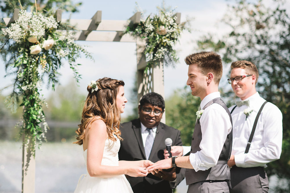 wedding arch and flowers in hair for okotoks alberta wedding