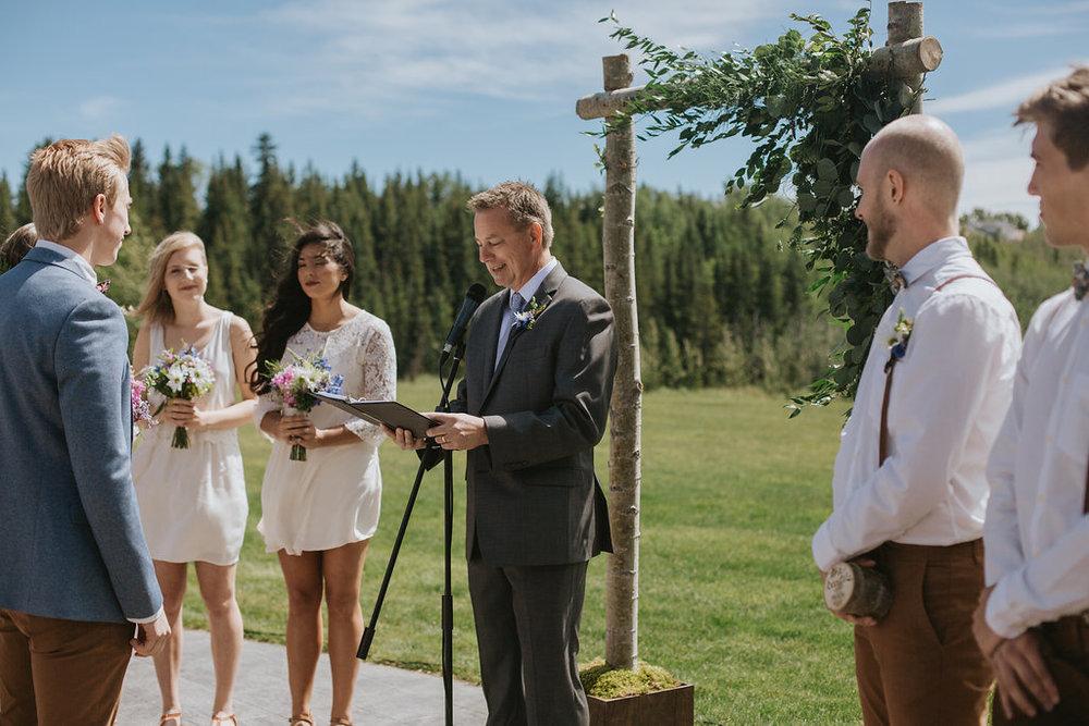 wedding arch and groomsmen flowers boutonnieres in cochrane, alberta