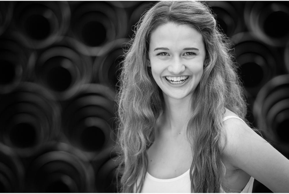 high school senior photo session inside truck with rolls of metal in denver | photographer jennifer koskinen | merritt portrait studio