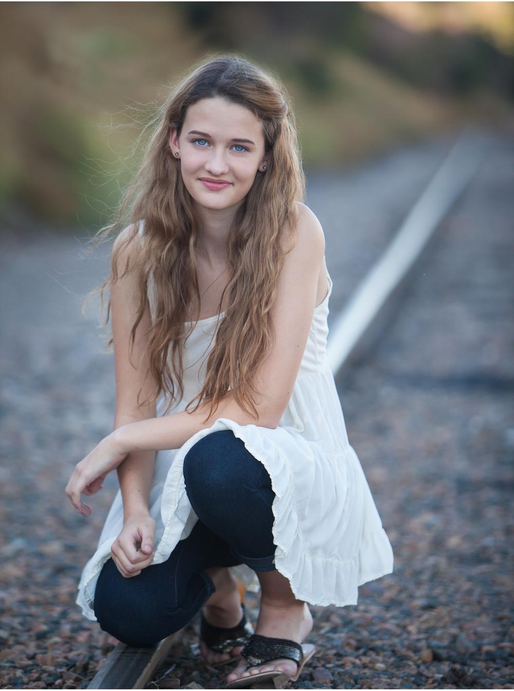high school senior photo session on out of use traintracks in denver | photographer jennifer koskinen | merritt portrait studio
