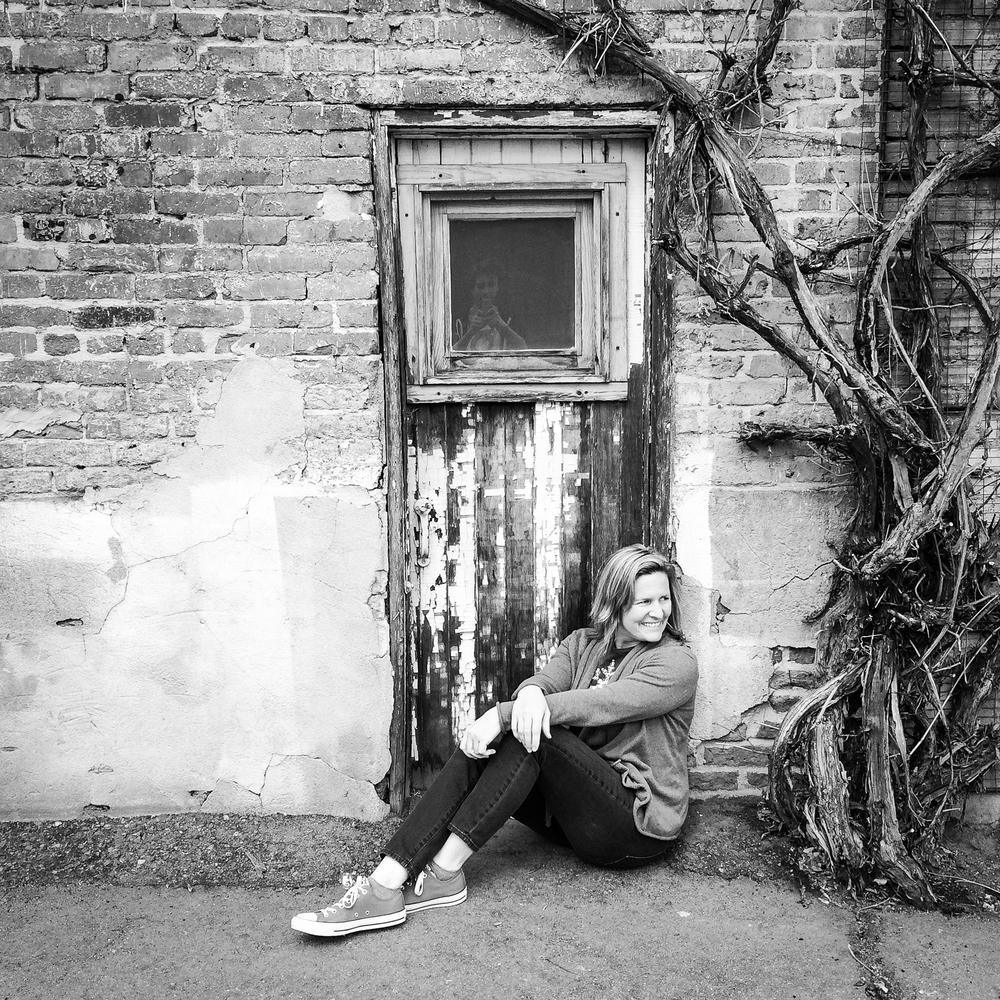 "In front of ""hobbit door"" at rustic portrait session location scouting at Blanc, Denver, with portrait photographer Jennifer Koskinen 