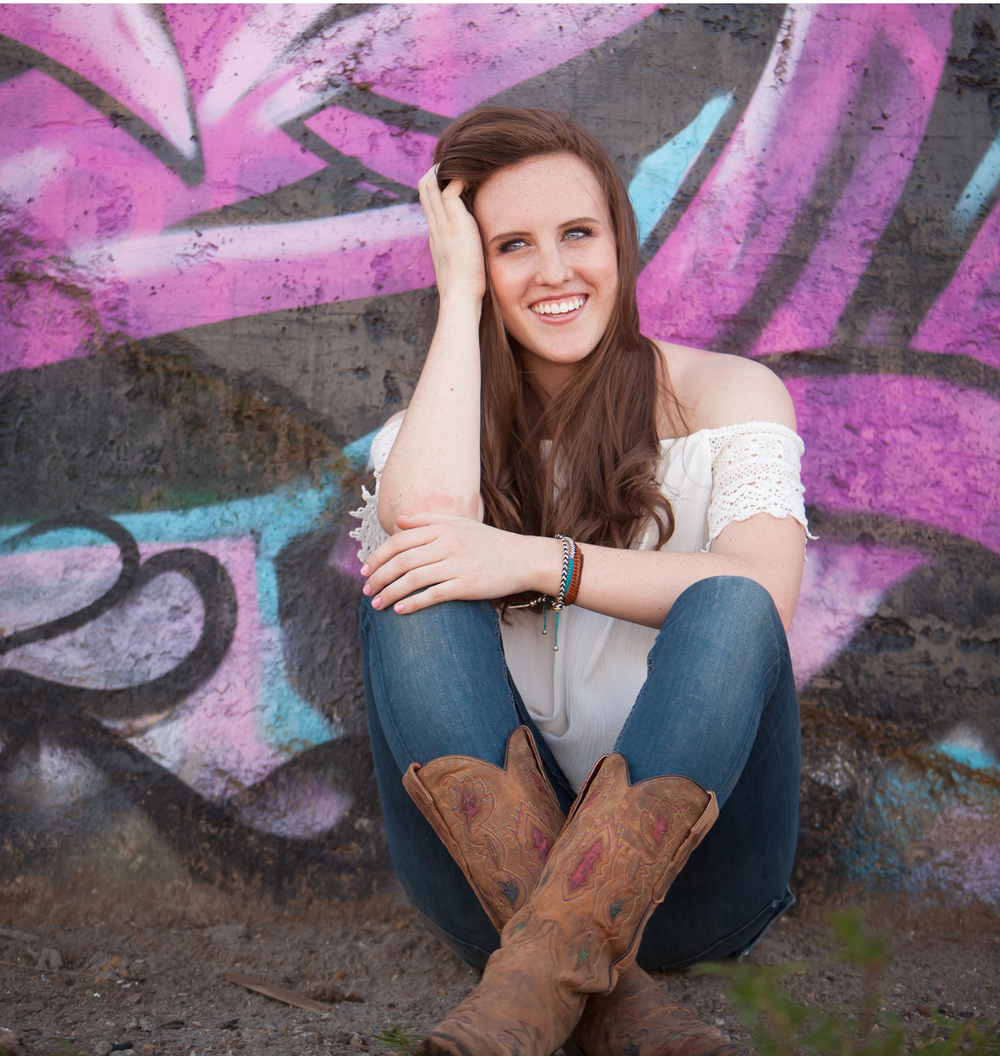 High School Senior Portrait with purple graffiti in Denver