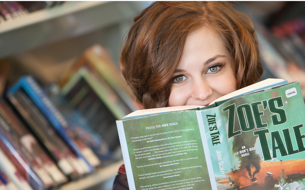 High School Senior Portrait with books inside Denver Public Library, with photographer Jennifer Koskinen of Merritt Portrait Studio