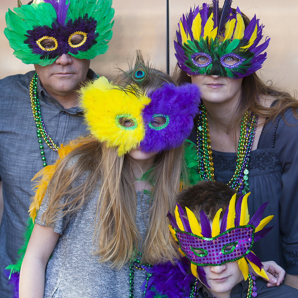 Family Pictures with Mardis Gras masks in Denver with photographer Jennifer Koskinen