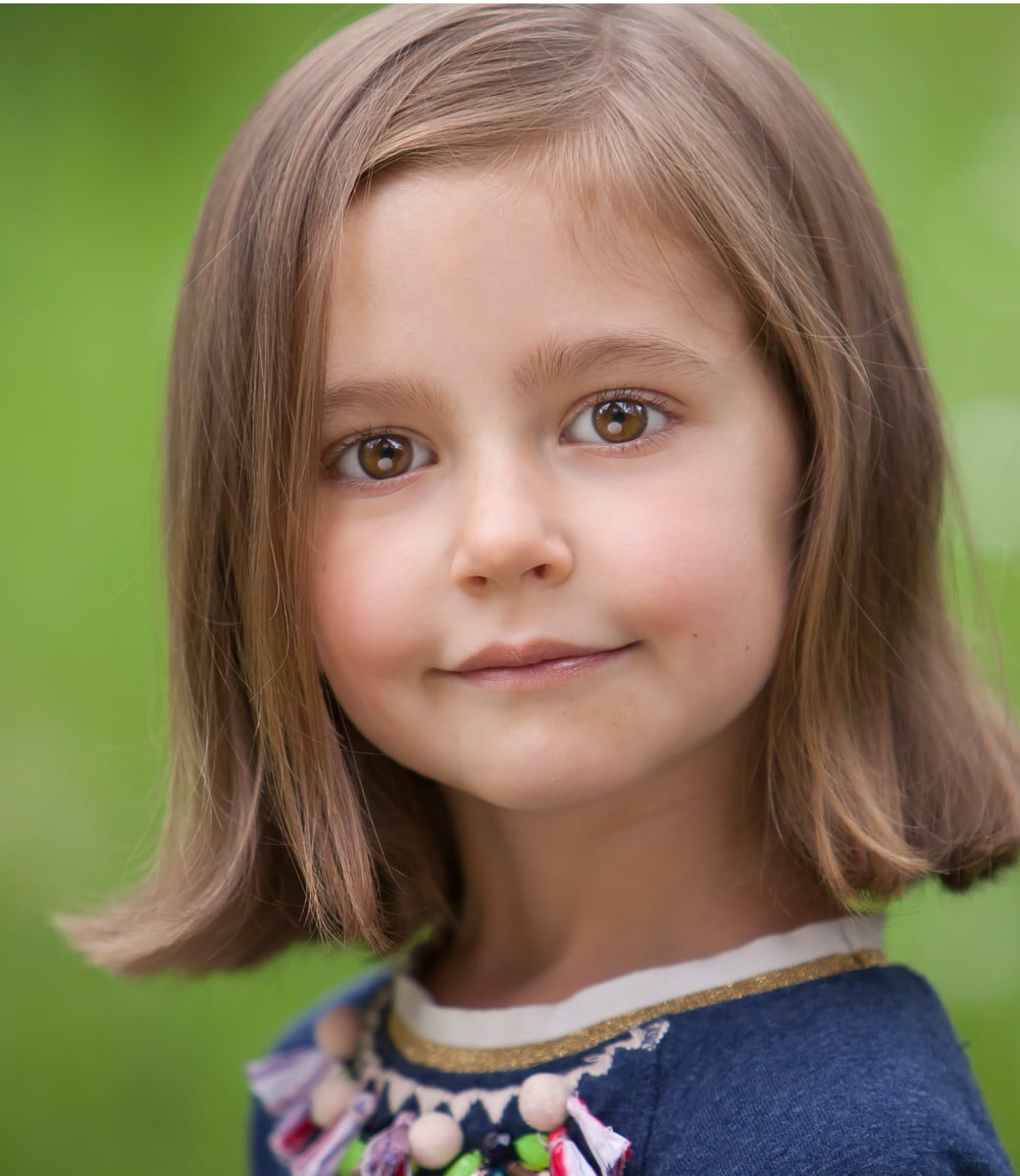 Brown eyed girl! Adorable child poses for her actor headshot, for Denver photographer Jennifer Koskinen | Merritt Portrait Studio
