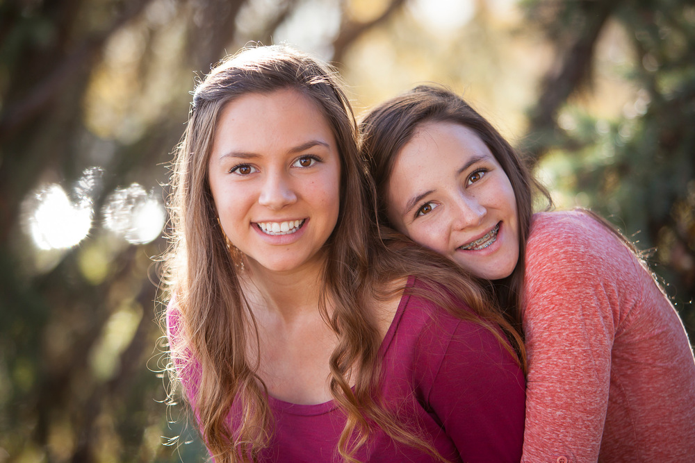 Outdoor fall photo of Sisters with Denver Photographer Jennifer Koskinen | Merritt Portrait Studio