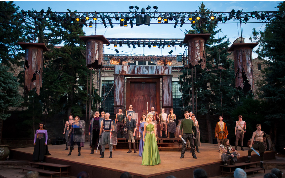 The outdoor setting of the Mary Rippon Theatre provides a spectacular backdrop for the set design that changes throughout the evening. Wide photo of Troilus & Cressida at Colorado Shakespeare Festival, photographed by Gabe Koskinen for Merritt Portrait Studio