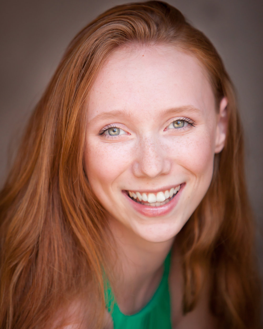 natural light headshot of redhead young woman ingenue in Denver, with photographer Jennifer Koskinen, Merritt Portrait Studio