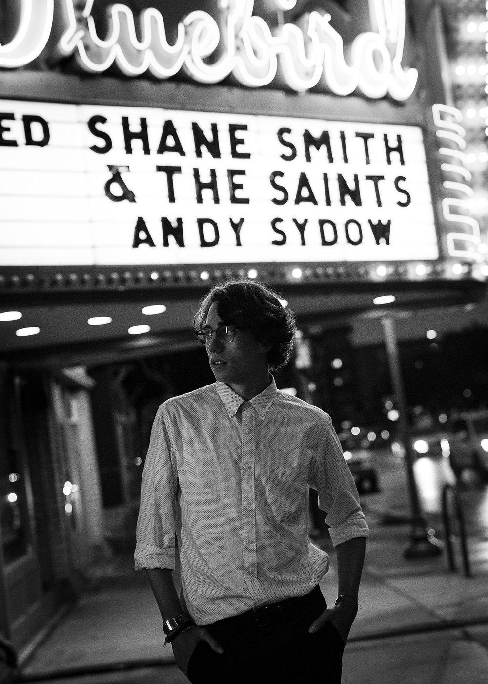 High School Senior Guy Portraits, photographed at night outside Bluebird Theater on Colfax, with photographer Jennifer Koskinen, Merritt Portrait Studio