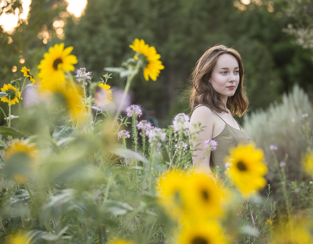 High School Senior Girl Portraits, photographed in Denver Botanic Gardens with sunflowers, with photographer Jennifer Koskinen, Merritt Portrait Studio